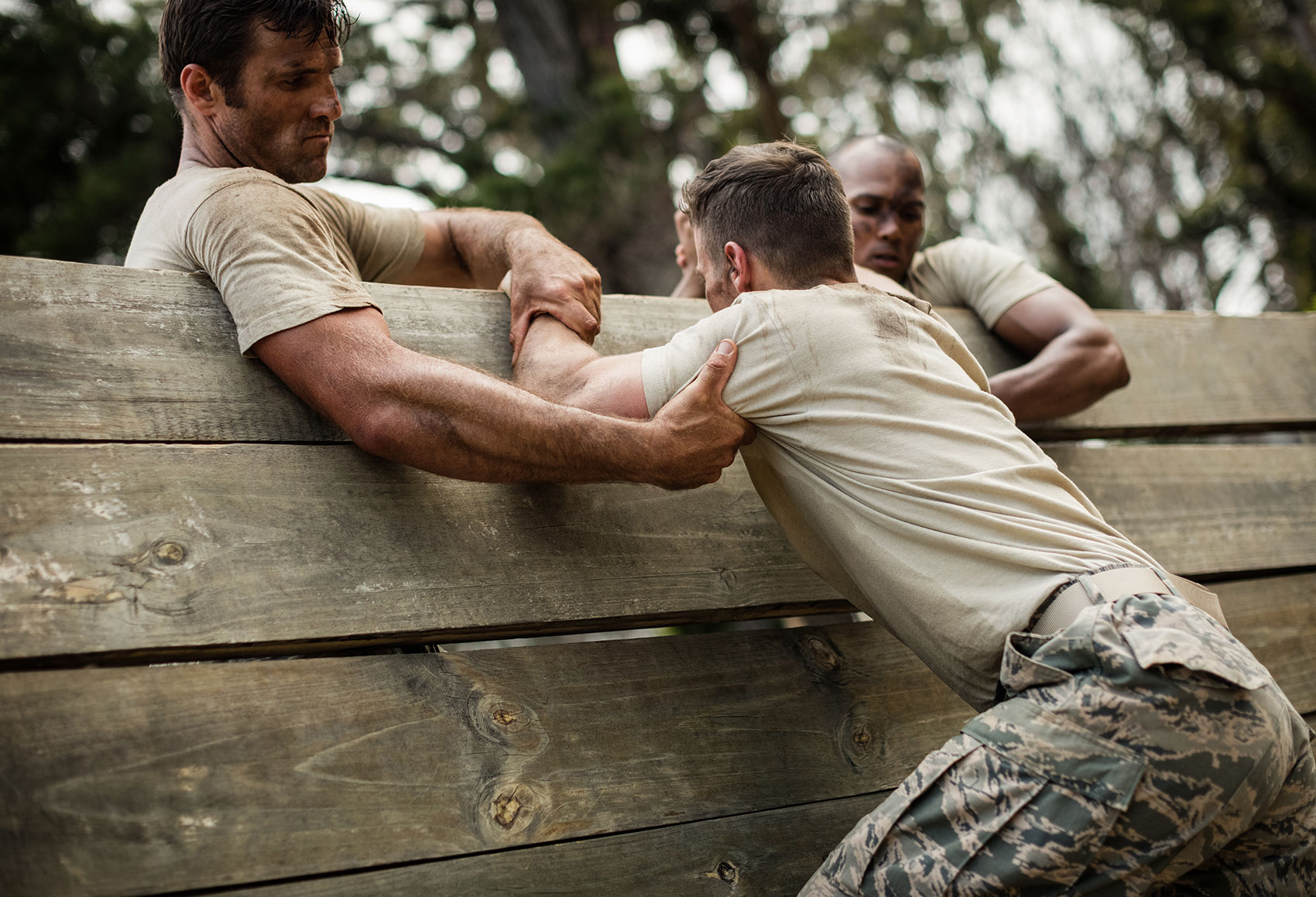 Army values men working out on field