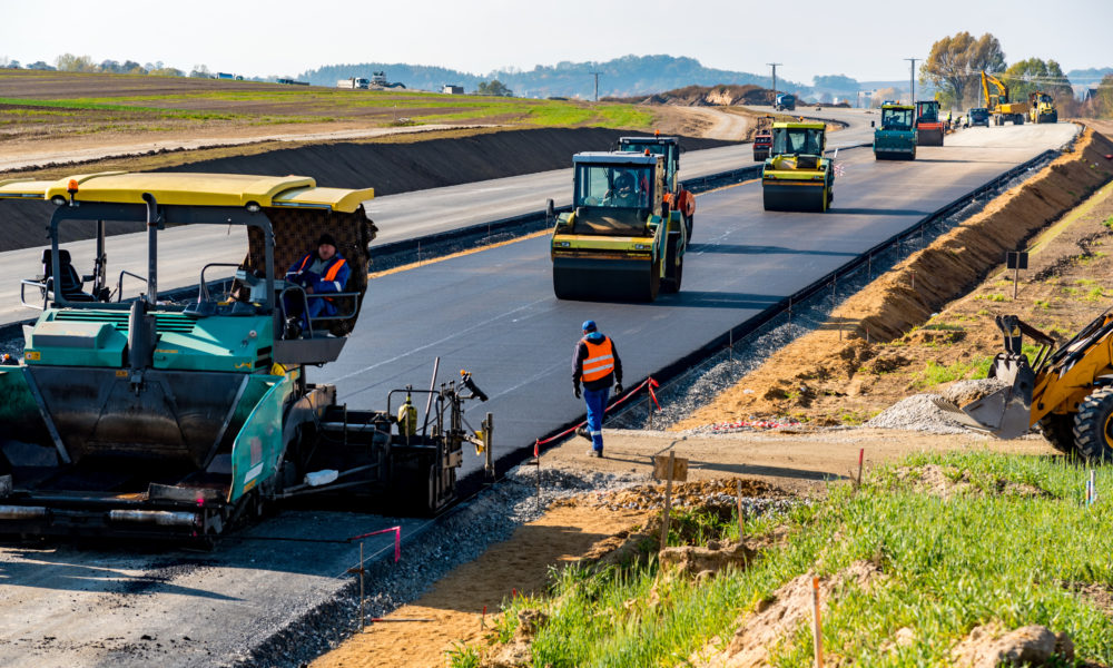 Road rollers building the new asphalt road